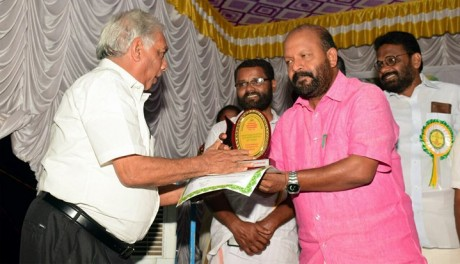 Pappy daniel receiving the special award from the Minister of Agriculature Mr. Sunilkumar
